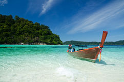 Boat waiting for tourist in clear sea and white sand beach at Li Royalty Free Stock Photography