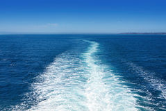 Boat Wake. In the sea, on a brilliant sunny day. This is the view behind a car ferry stock photography