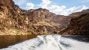 Boat Wake on Canyon Lake in Arizona. Wake of boat on the water of of Canyon Lake surrounded by red rock mountains in Arizona, USA Stock Photography