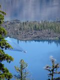 Boat with wake on Crater Lake in Oregon royalty free stock image