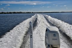 Boat Wake in Florida. Power boat throws wake in waterway at Pine Island, Florida stock photography