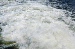 Boat wake foam Stock Photo
