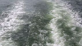 Boat wake in the harbor stock video