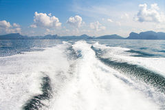 Boat wake prop wash on blue ocean sea. In sunny day royalty free stock image