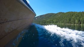 Boat with wake in river 4k. Boat with wake in river on a sunny day 4k stock footage