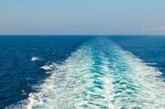 Boat wake in the sea Stock Photo