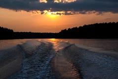 Boat Wake at Sunset Stock Photo
