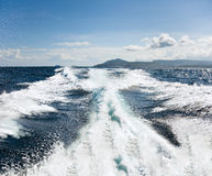 Boat wake on the water Royalty Free Stock Image