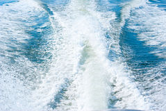 Boat wake water turbulence and motor waves. Boat wake from a high powered boat motor pushing a boat at high speed Royalty Free Stock Photography