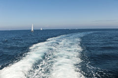 Boat wake with yachts in background. On the mediterranean Sea wallpaper. Copyspace stock photos