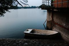 Lonely boat or raft on the corner of a lake stock image