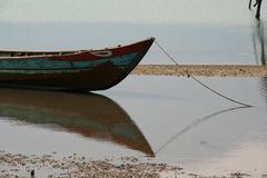 A boat was moored at the edge of a river near a fishermens village in Vietnam Royalty Free Stock Photography