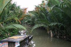 A boat was moored at the edge of a river in Vietnam Stock Photos