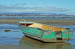 Boat Washed Ashore. Severe flooding and spring storms on Georgian Bay wash an old aluminum boat ashore at Wasaga Beach, Ontario Royalty Free Stock Image