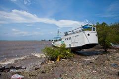 Boat washed up stock image