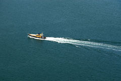 Boat on the water. Birdeye view of the sea surface with motor boat Stock Photo