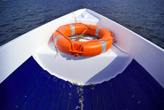Boat in the water. Boat in th water with safety curl Royalty Free Stock Image
