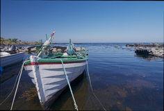 Boat in water. A boat lies in a small natural harbor on the island of Bornholm Royalty Free Stock Photo
