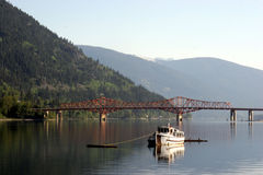 A boat on the water. A boat is morred on the west arm of Kootenay Lake in Nelson, BC Stock Photos