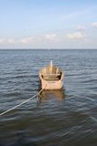 Boat in Water. A boat in water tied up with a rope royalty free stock photography