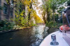 A boat on water during the autumn season. Colorfull trees and leaf stock image
