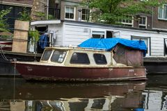 Boat in the water canal in Amsterdam. Netherlands Royalty Free Stock Photos