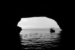 Boat in water cave Stock Images