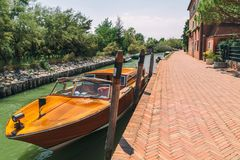 Boat and water channel in Tiny Torcello island near Venice, Ital Royalty Free Stock Photography