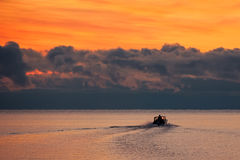 Boat on water on contrast sunrise background Royalty Free Stock Photos