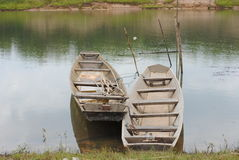 Boat and water. Fishing boats of local fishermen made of wood. In roaming across the shore and fishing in the river or lake Stock Photos
