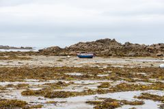Boat at low tide. A boat without water at low tide royalty free stock photos