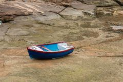 Boat at low tide. A boat without water at low tide stock photography