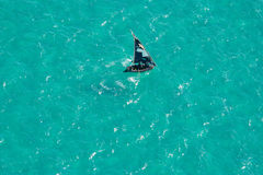 Boat on water, Mozambique, southern Africa. Aerial view of a small sailboat (called a dhow) on the open sea, Mozambique, southern Africa Royalty Free Stock Image
