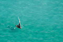 Boat on water, Mozambique, southern Africa. Aerial view of a small sailboat (called a dhow) on the open sea, Mozambique, southern Africa stock images