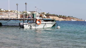 Boat of water police. Standing in the sea near the pier on the Red Sea stock video footage