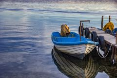 Boat with water reflection Royalty Free Stock Images