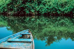 Boat on the water and reflection royalty free stock photography