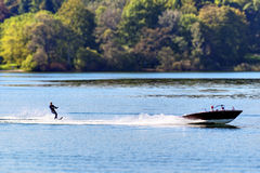 Boat with water skier Stock Photo