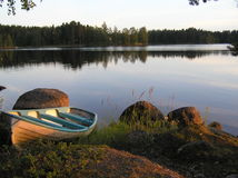 Boat on the Waterfront. Rowing-boat on the waterfront of a swedish lake at sunset Stock Images
