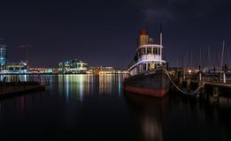 Boat on waterfront with city lights