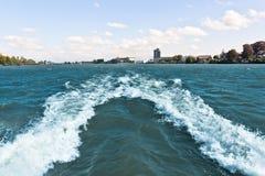 Boat waves. Splash water wave behind boat underway Royalty Free Stock Photo