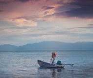 Boat on the waves at sunset, seascape Stock Image
