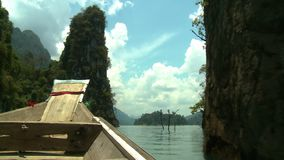 Boat Weaves Around Mountainous Walls. Handheld, wide shot from inside a boat as it weaves around mountainous walls stock video