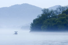 A boat on west lake. A boat on foggy west lake Royalty Free Stock Image