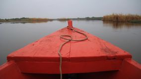 Boat in the wetlands. Of the wildlife reserve Biotopo Monterrico-Hawaii, Guatemala stock video