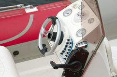 Boat wheel. Modern boat wheel and controls royalty free stock photos