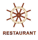 Boat wheel with restaurant  Stock Photography