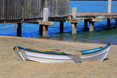 Boat. White and blue boat by the bay Royalty Free Stock Images