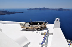 Boat on the white roof. Santorin Stock Photos