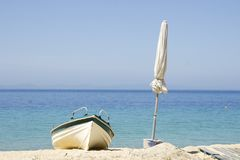 Boat and white umbrella stock photos